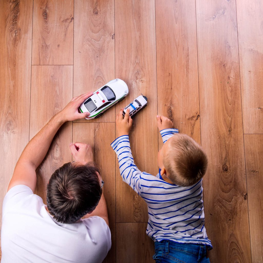 Father and kid playing with toycar | Pucher's Decorating Centers